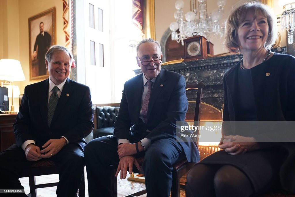 U.S. Senate Minority Leader Sen. Chuck Schumer (D-NY) (C) speaks to Sen. Doug Jones (D-AL) (L) and Sen. Tina Smith (D-MN) during a meeting at the U.S. Capitol January 3, 2018 in Washington, DC. Schumer held a meeting with the two newly sworn-in Democratic Senators in his office.