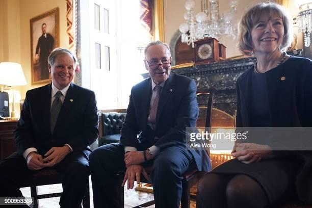 S Senate Minority Leader Sen Chuck Schumer speaks to Sen Doug Jones and Sen Tina Smith during a meeting at the US Capitol January 3 2018 in...