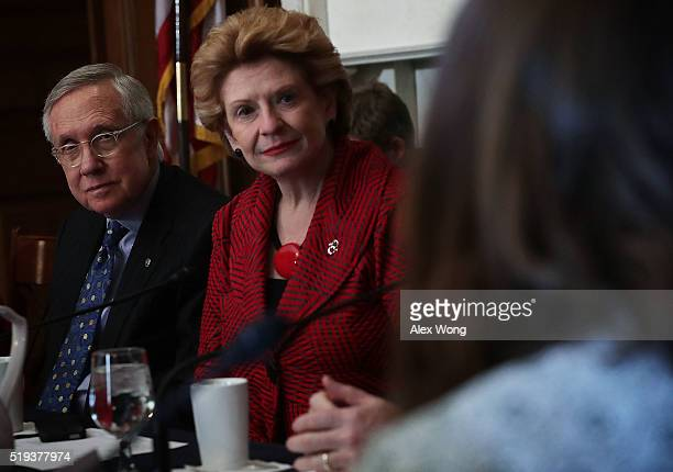 S Senate Minority Leader Sen Harry Reid and Sen Debbie Stabenow listen during a Senate Democratic Steering and Outreach Committee forum April 6 2016...