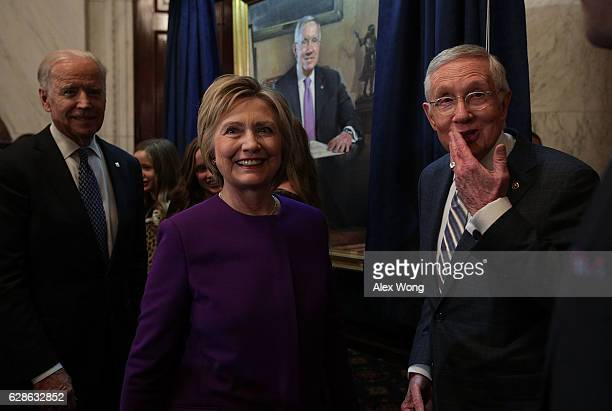 S Senate Minority Leader Sen Harry Reid former Secretary of State Hillary Clinton and Vice President Joseph Biden during Reid's leadership portrait...