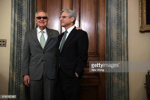 S Senate Minority Leader Sen Harry Reid meets with Supreme Court nominee Merrick Garland March 17 2016 on Capitol Hill in Washington DC Garland is...