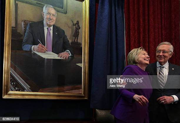 S Senate Minority Leader Sen Harry Reid shares a moment with former Secretary of State Hillary Clinton during Reid's leadership portrait unveiling...