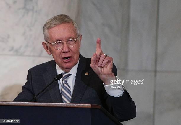 S Senate Minority Leader Sen Harry Reid speaks during his leadership portrait unveiling ceremony December 8 2016 on Capitol Hill in Washington DC The...