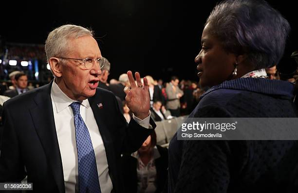 S Senate Minority Leader Sen Harry Reid speaks with DNC Chair Donna Brazile before the start of the third US presidential debate at the Thomas Mack...