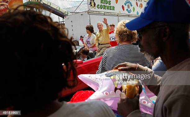 Senate Minority Leader Sen Mitch McConnell and his wife Elaine Chao ride in the Adairville Strawberry Festival parade while campaigning for the...