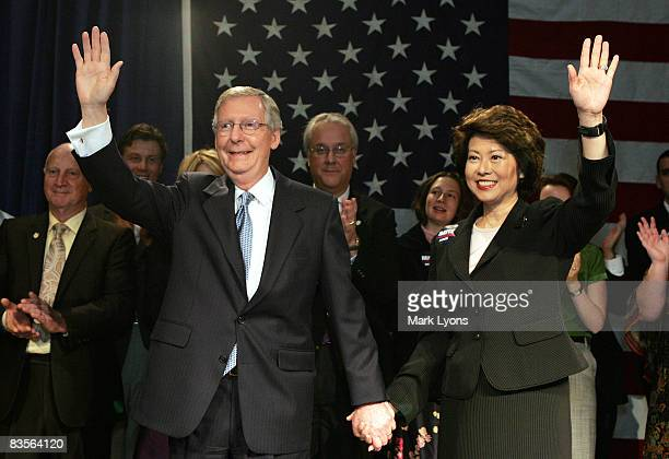 S Senate Minority Leader Sen Mitch McConnell and his wife U S Secretary of Labor Elaine Chao greet supporters after learning he has defeated...