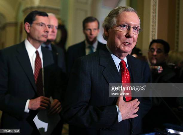 Senate Minority Leader Sen Mitch McConnell speaks to the media while flanked by Sen John Barrasso Senate Minority Whip Sen John Cornyn and Sen John...