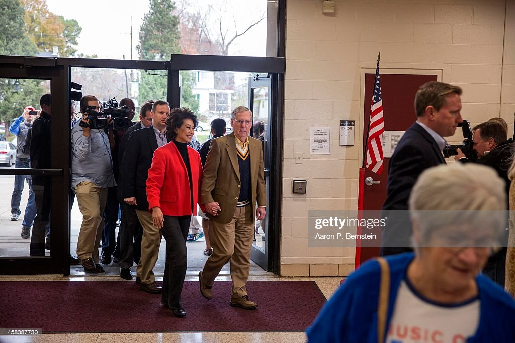 Senate Minority Leader U.S. Sen. Mitch McConnell (R-KY) arrives to vote in midterm elections with his wife Elaine Chao at Bellarmine University November 4, 2014 in Louisville, Kentucky. McConnell is running in a tight race against opponent Kentucky Secretary of State Alison Lundergan Grimes.