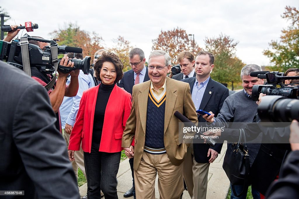 Senate Minority Leader U.S. Sen. Mitch McConnell (R-KY) departs after voting in midterm elections with his wife Elaine Chao at Bellarmine University November 4, 2014 in Louisville, Kentucky. McConnell is running in a tight race against opponent Kentucky Secretary of State Alison Lundergan Grimes.
