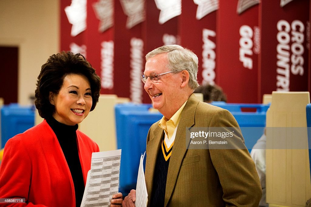 Senate Minority Leader U.S. Sen. Mitch McConnell (R-KY) waits after voting in midterm elections with his wife Elaine Chao at Bellarmine University November 4, 2014 in Louisville, Kentucky. McConnell is running in a tight race against opponent Kentucky Secretary of State Alison Lundergan Grimes.
