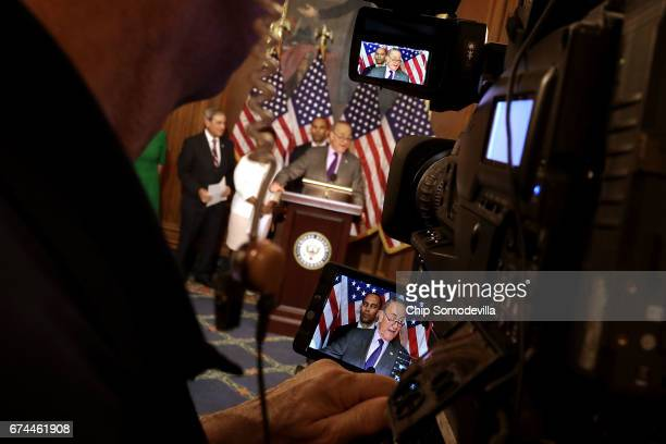 Senate Minority Leadery Charles Schumer appears on a television camera screen with fellow Democrats from the House and Senate during a news...