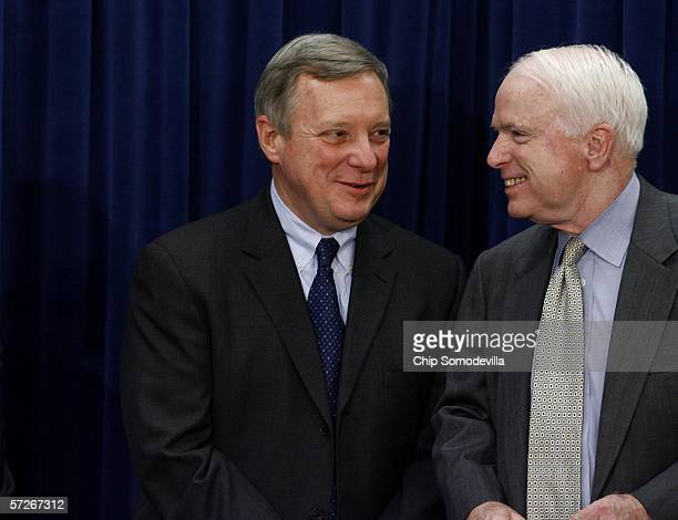 Senate Minority Whip Richard Durbin and U.S. Sen. John McCain talk during a news conference at the Capitol April 6, 2006 in Washington, DC. Senators...