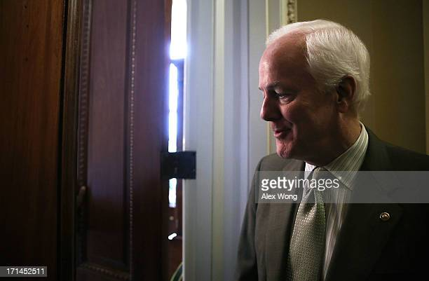 S Senate Minority Whip Sen John Cornyn returns to his office after a vote on the Senate floor June 24 2013 on Capitol Hill in Washington DC The...