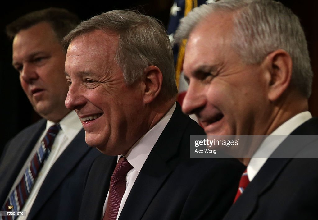 U.S. Senate Minority Whip Sen. Richard Durbin (D-IL) (2nd L), Sen. Jack Reed (D-RI) (R), and Sen. Jon Tester (D-MT) (L) participate in a news conference June 4, 2015 on Capitol Hill in Washington, DC. The senators held a news conference to discuss the National Defense Authorization Act.