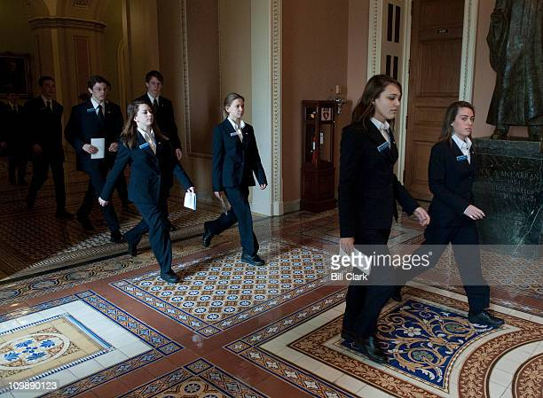 Senate pages follow the procession of Senators to the House chamber for Australian Prime Minister Julia Gillard's speech to a joint meeting of...