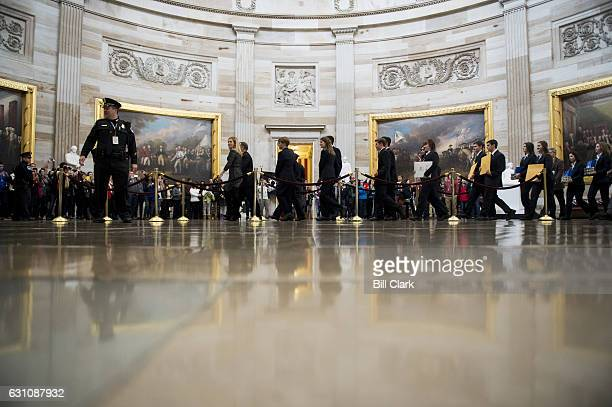 Senate pages lead the procession of the Senate through the US Capitol Rotunda into the House chamber with the Electoral College ballot boxes on...