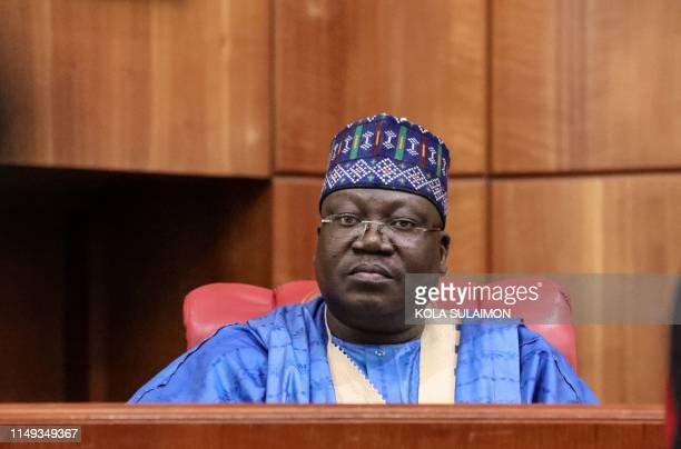 Senate President Ahmed Lawan looks on as he is being sworn in as Senate President during the inauguration of the Nigerian 9th National Assembly in...