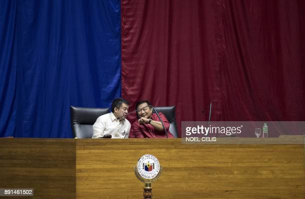 Senate President Aquilino Pimentel and House Speaker Pantaleon Alvarez chats during the during the deliberations to extend Martial Law in Mindanao at...