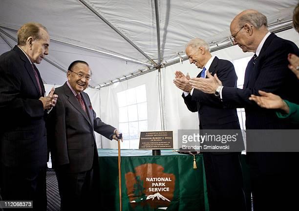 Senate President Pro Tempore Senator Daniel K Inouye Vice President Joseph Biden and Senator Pat Roberts present former Senator Bob Dole with a...