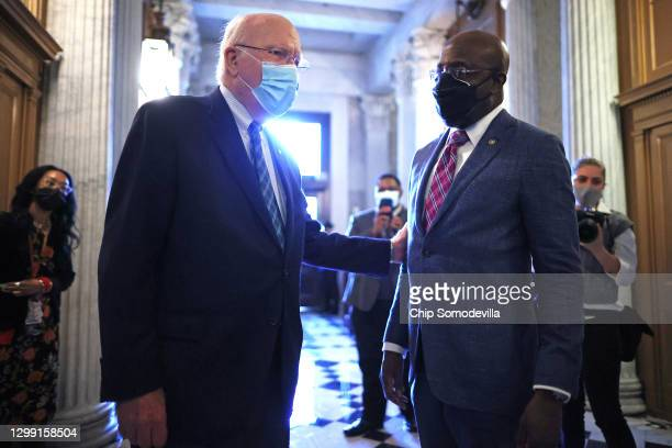 Senate President Pro Tempre Patrick Leahy talks with Sen. Raphael Warnock outside the Senate Chamber during a procedural vote on the confirmation of...