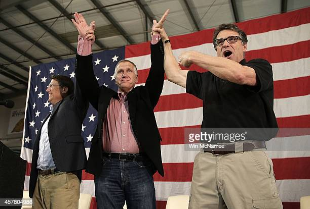 S Senate Republican candidate and North Carolina House Speaker Thom Tillis campaigns with Texas Gov Rick Perry and North Carolina Gov Pat McCrory at...