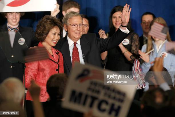 S Senate Republican Leader Sen Mitch McConnell and his wife Elaine Chao wave to supporters after a victory celebration following McConnell's victory...