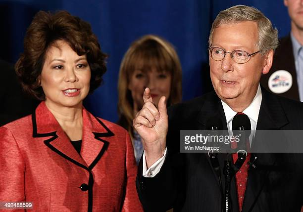 S Senate Republican Leader Sen Mitch McConnell speaks to supporters with his wife Elaine Chao during a victory celebration following McConnell's...