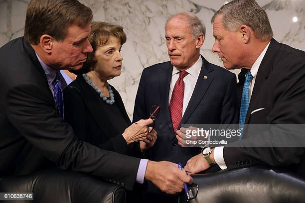 Senate Select Committee on Intelligence members Sen Mark Warner Sen Dianne Feinstein Sen Dan Coats and Chairman Richard Burr confer before hearing...