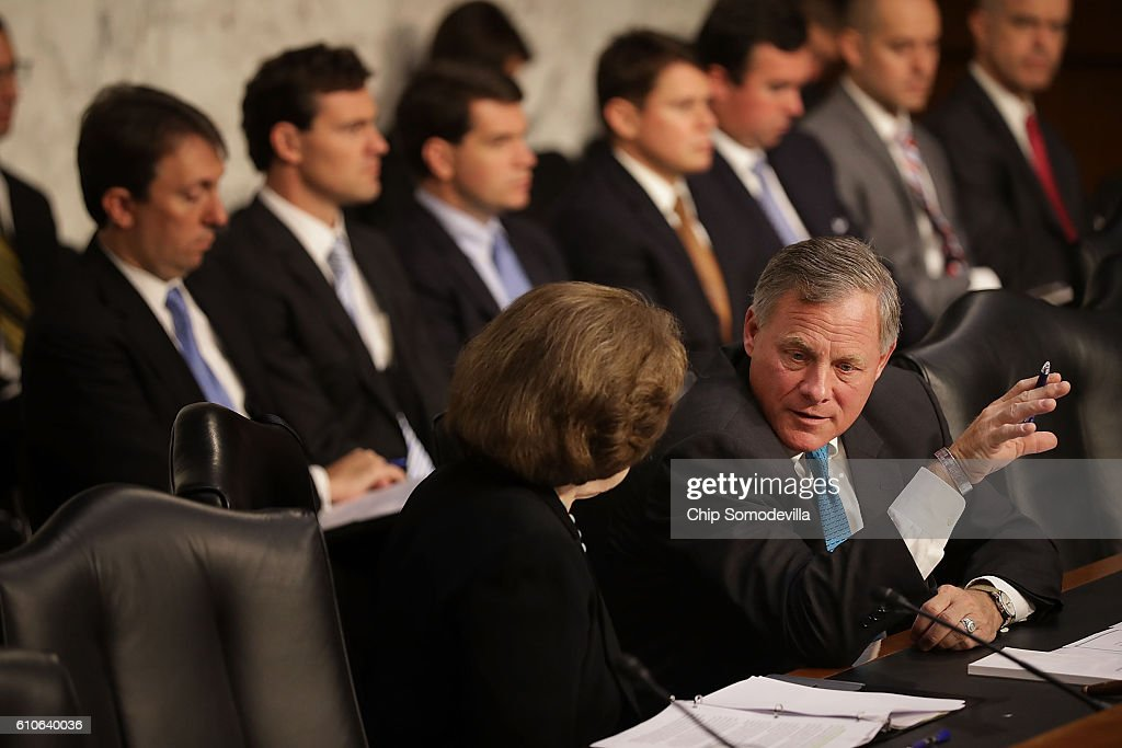 Senate Select Committee on Intelligence ranking member Sen. Dianne Feinstein (D-CA) and Chairman Richard Burr (R-NC) talk while hearing testimony from National Geospatial-Intelligence Agency Director Robert Cardillo in the Hart Senate Office Building on Capitol Hill September 27, 2016 in Washington, DC. This was the first time in the agency's 20 years that the director testified in an open hearing.
