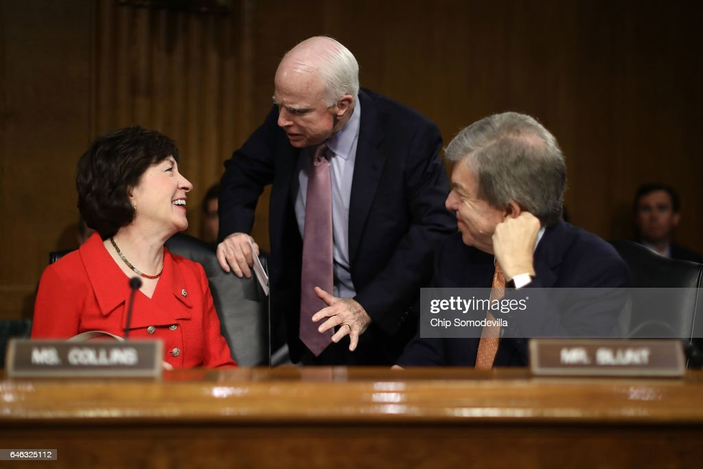 Senate Select Intelligence Committee members (L-R) Sen. Susan Collins (R-ME), Sen. John McCain (R-AZ) and SEn. Roy Blunt (R-MO) visit before the confirmation hearing for former U.S. Senator Dan Coats to be the next Director of National Intelligence in the Dirksen Senate Office Building on Capitol Hill February 28, 2017 in Washington, DC. A former ambassador to Germany and a two-time Republican senator from Indiana, Coats is President Donald Trump's choice to be AmericaÕs top intelligence official.