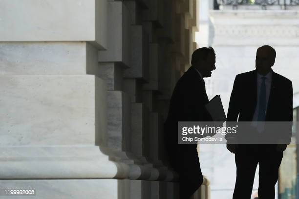 Senate Sergeant at Arms Michael Stenger greets Supreme Court Chief Justice John Roberts as he arrives at the U.S. Capitol on their way to the U.S....