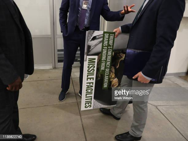 Senate staffer holds a poster that was used on the Senate floor during the debate on President's national emergency border declaration at the US...