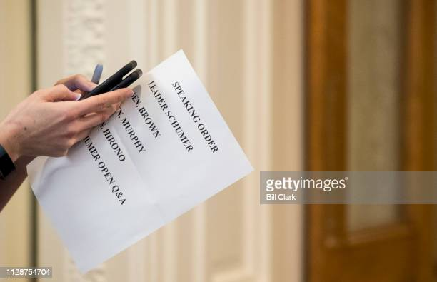 Senate staffer holds a sheet listing the speaking order for the press conference with Senate Minority Leader Chuck Schumer DNY Sen Sherrod Brown...