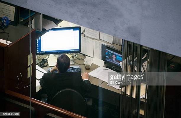 Senate staffer works at his desk in the Hart Senate Office Building on Monday Sept 29 2014