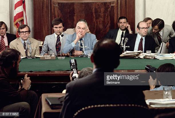 Senate Watergate committee Chairman Sen Sam Ervin questions former presidential aide John Ehrlichman during the panel's hearing Seated at left is...