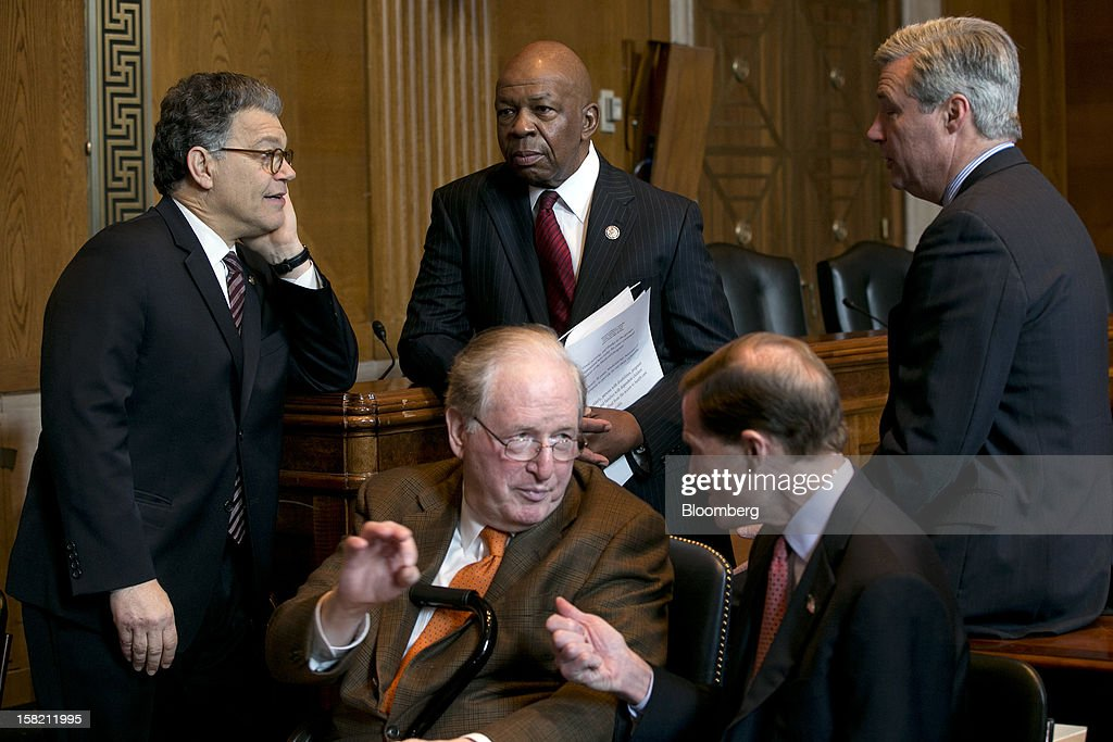 Senator Al Franken, a Democrat from Minnesota, top row left to right, Representative Elijah Cummings, a Democrat from Maryland, and Senator Sheldon Whitehouse, a Democrat from Rhode Island, talk prior to a news conference with Senator John Rockefeller, a Democrat from West Virginia, bottom row left, and Senator Richard Blumenthal, a Democrat from Connecticut, in Washington, D.C. U.S., on Tuesday, Dec. 11, 2012. Democratic lawmakers want Medicaid funding protected in the fiscal cliff talks. Photographer: Andrew Harrer/Bloomberg via Getty Images