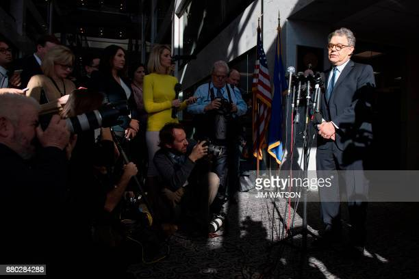 US Senator Al Franken Democrat of Minnesota speaks outside his office on Capitol Hill in Washington DC on November 27 2017 Charges of sexual...