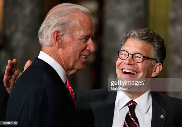 Senator Al Franken shares a laugh with Vice President Joseph Biden after a swearing in reenactment ceremony on Capitol Hill July 6 2009 in Washington...