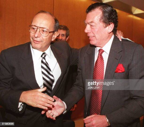 Senator Alfonse D'Amato is welcomed by World Jewish Congress President Edgar Bronfman 23 October in New York at a meeting to update the media on the...