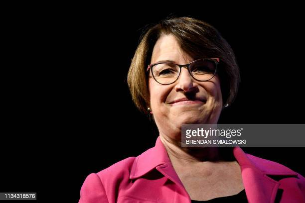 """Senator Amy Klobuchar , a 2020 US presidential hopeful, pauses while speaking during the """"We the People"""" gathering at the Warner Theatre on April 1..."""