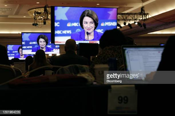 Senator Amy Klobuchar a Democrat from Minnesota and 2020 presidential candidate is seen on television screens during the Democratic presidential...