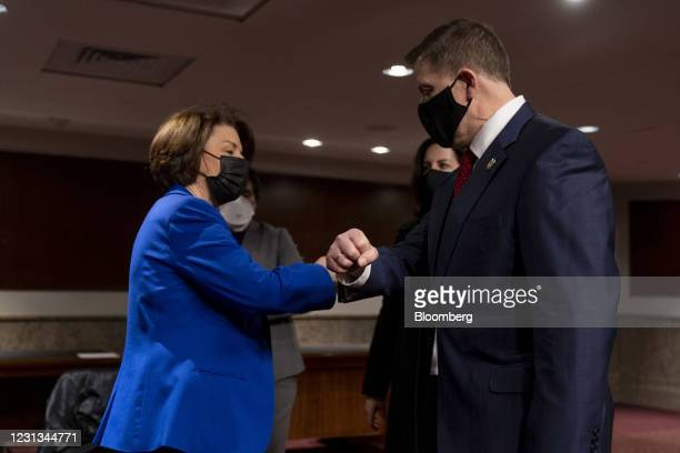 Senator Amy Klobuchar, a Democrat from Minnesota, left, greets Steven Sund, former Capitol chief of police, following a Senate Homeland Security and...