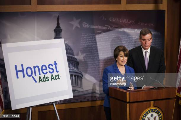 Senator Amy Klobuchar a Democrat from Minnesota speaks as Senator Mark Warner a Democrat from Virginia listens during a press conference introducing...