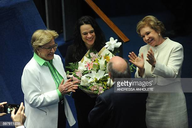 Senator Ana Amelia gives a bouquet of flowers to Brazilian jurist Janaina Paschoal coauthor of the complaint against suspended President Dilma...