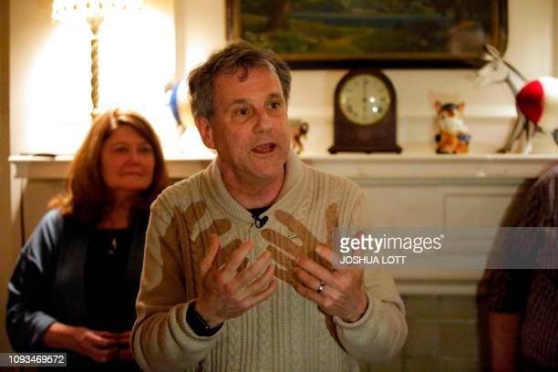 US Senator and 2020 presidential candidate Sherrod Brown speaks at a house party as his wife Connie Schultz looks on during a campaign stop on...