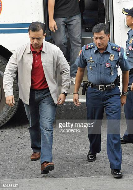 Senator and exnavy lieutenant Antonio Trillanes handcuffed to a guard arrives for a court hearing in the financial district Makati suburban Manila on...