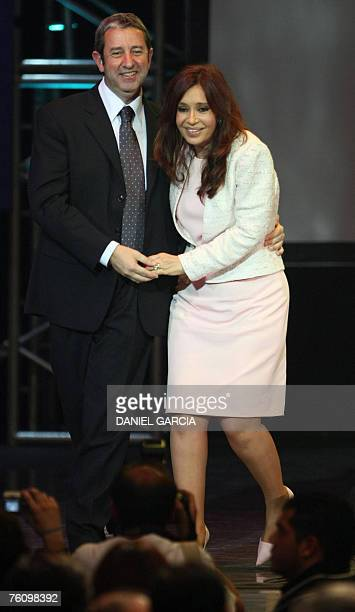 Senator and first lady Cristina Fernandez de Kirchner and the governor of the province of Mendoza Julio Cobos hug each other 14 August 2007 in Buenos...