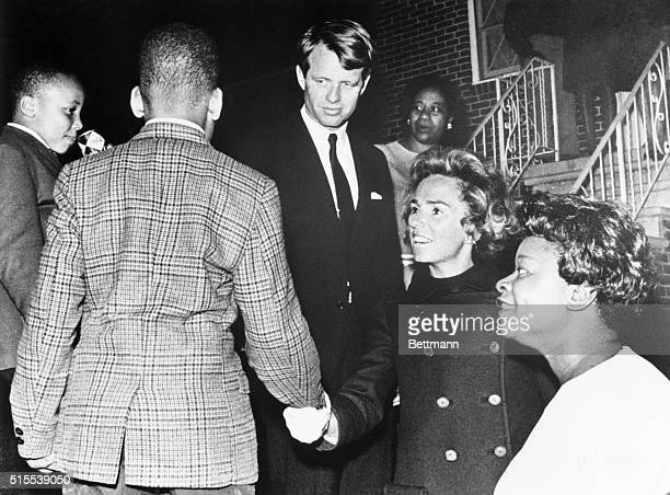 Senator and Mrs. Robert Kennedy at the home of the late Dr. Martin Luther King, Jr. In Atlanta shaking hands with young Martin Luther King III while...