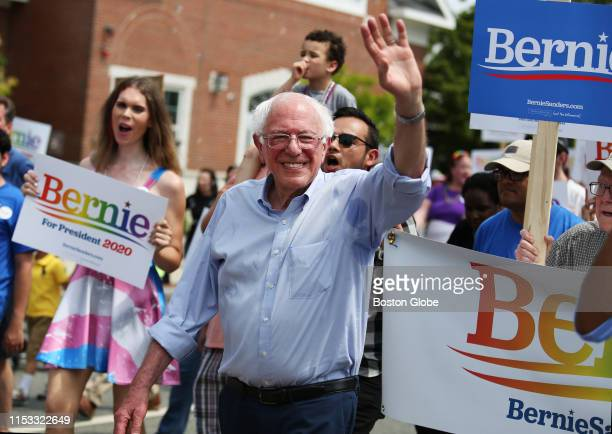 S Senator and presidential candidate Bernie Sanders waves to supporters while marching down Main Street in the Nashua Pride parade in Nashua NH on...