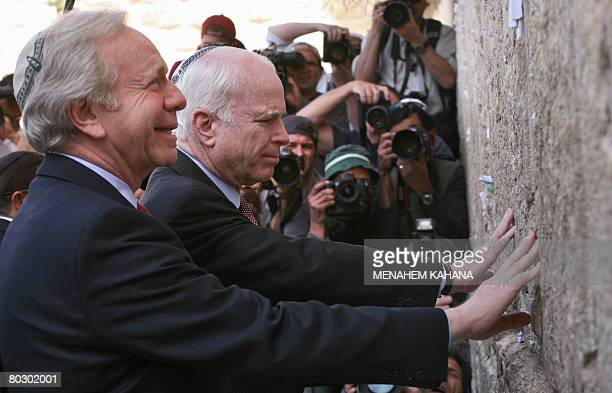 US Senator and Republican presidential candidate John McCain and Senator Joseph Lieberman visit the Western Wall in Jerusalems old city on March 19...